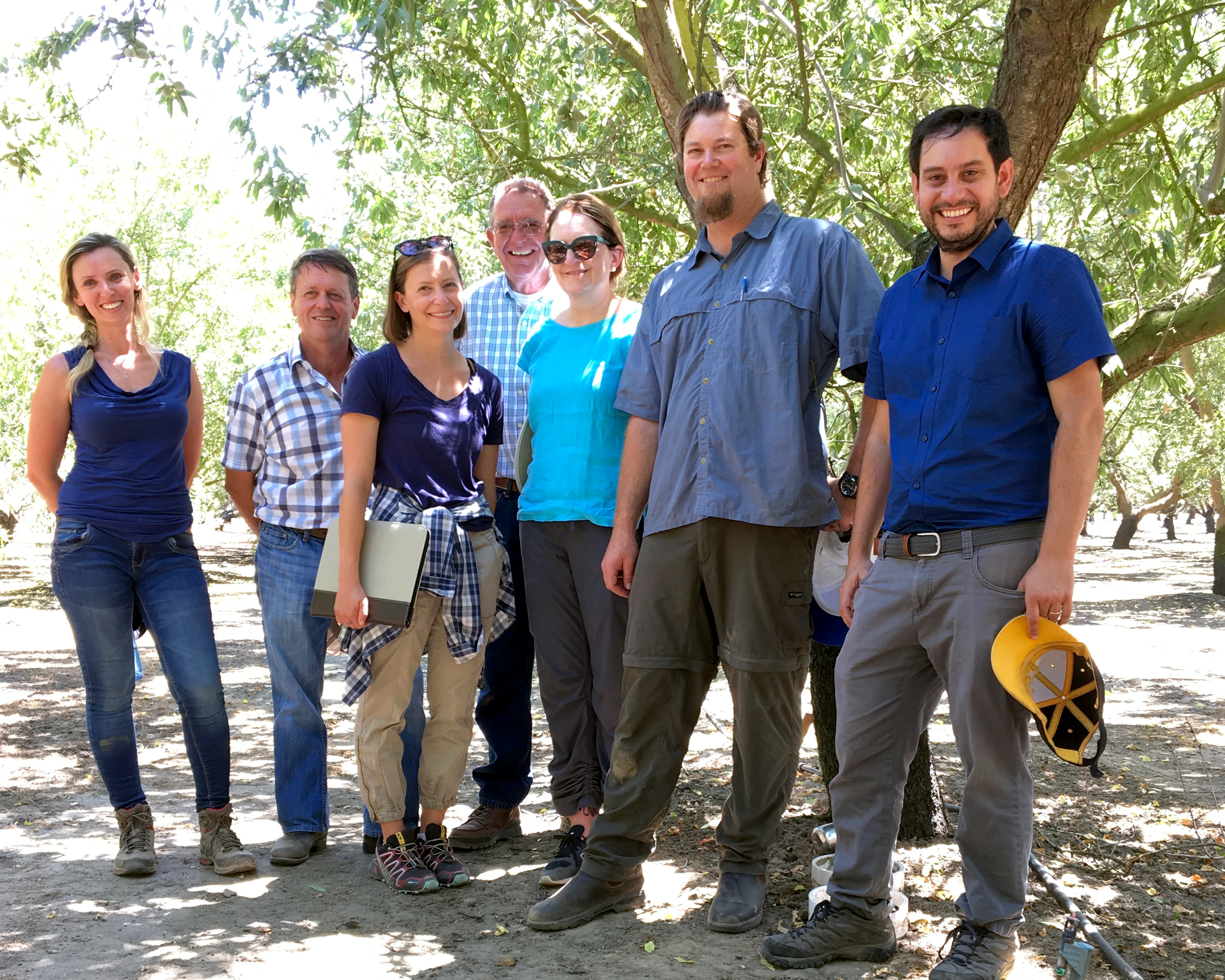 Collaborators gather to study nitrogen efficiency in a Modesto almond orchard, including, from left, postdoctoral researcher Hanna Ouaknin; Professor Patrick Brown; Ph.D. student Jessica Rudnick; grower Art Bowman; Professor Gail Taylor; Ph.D. student Patrick Nichols; and Sebastian Saa Silver, UC Davis alum and agricultural researcher with the California Almond Board.