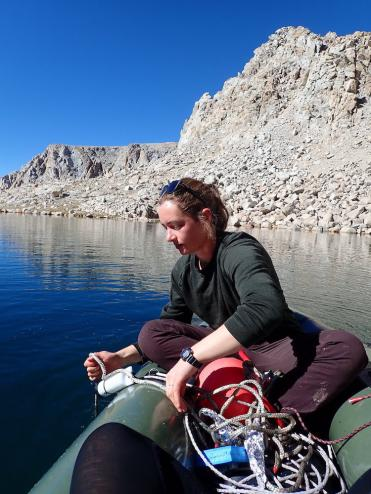 Adrianne Smits, a NSF postdoctoral fellow at UC Davis, deploys a mooring in a Yosemite lake. (E. Suenaga)