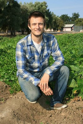 UC Davis Ph.D. student Travis Parker is helping breed bean varieties that can flourish in organic systems. (Bob Johnson/Ag Alert)