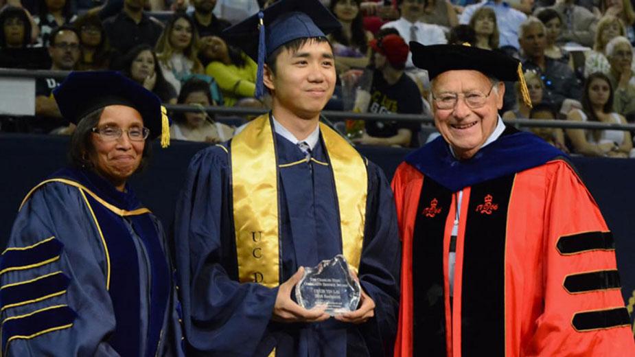 "Dean Dillard and Dean Emeritus Hess (in his Rutgers academic regalia) flank Chun Yin ""Anson"" Lai, recipient of a Charles Hess Community Service Award in 2016."