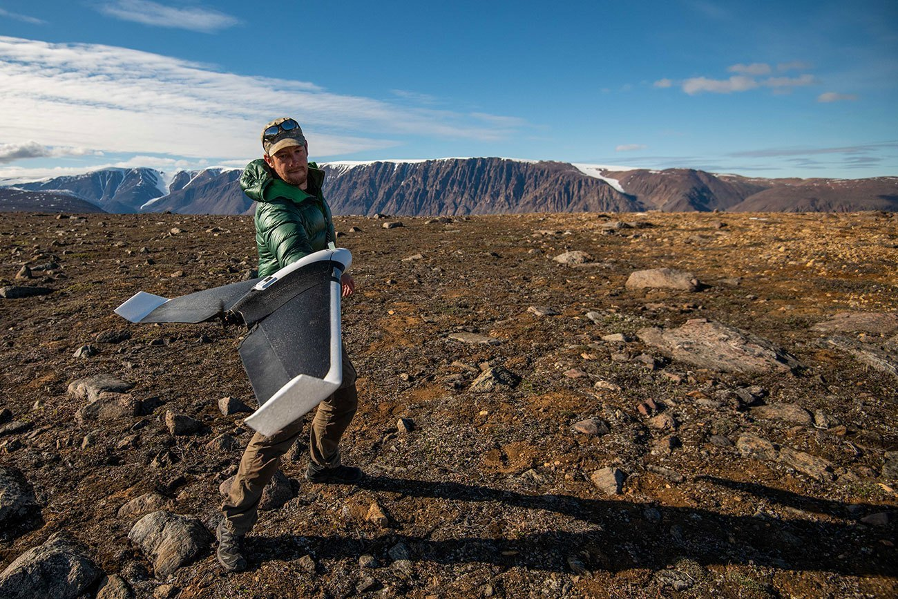 Jeffrey Kerby, a National Geographic Explorer and postdoctoral scholar at UC Davis, flies a drone to capture tundra vegetation change in the Arctic. (Isla Myers-Smith)