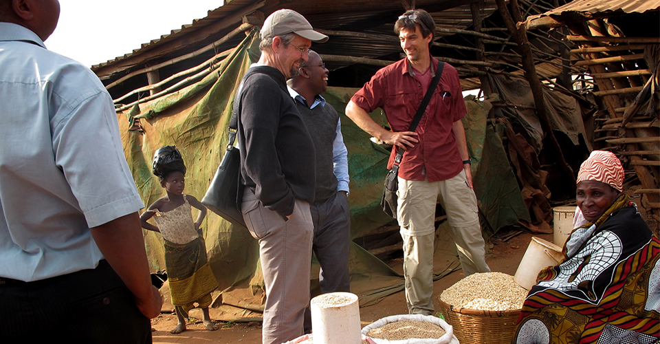 Principal investigators Michael Carter (third from left) and Stephen Boucher (second from right) visit a local market in Mozambique with their local research partners. (Jonathan Malacarne/AMA Innovation Lab)