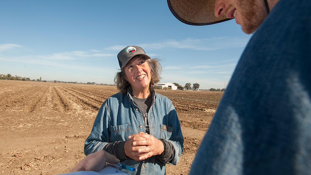 Professor Kate Scow talks with a student about soil health.