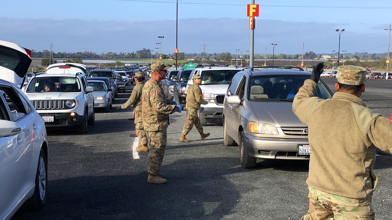 National Guard members helping out at drive-through food distributions. On this day, almost 3,000 families picked up a bag of food. (Photo Courtesy: Michelle Lee)