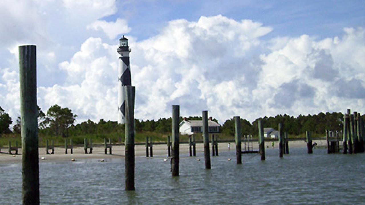 The Cape Lookout Lighthouse guards the second largest estuary in the U.S., the Albemarle-Pamlico Sound in North Carolina. Nearby areas that depend on the shellfish business face long-term economic risk from ocean acidification. (Photo: Chris J. Nicolini)