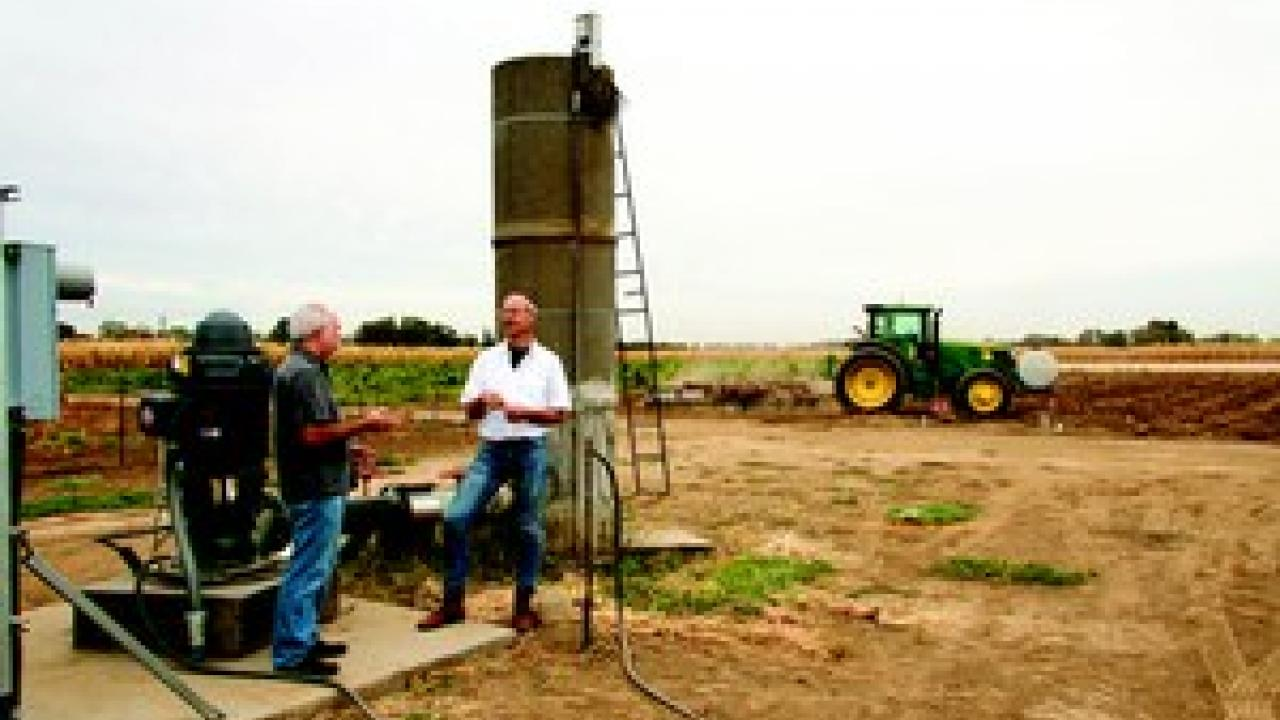 Professor Graham Fogg (left) and Cooperative Extension Specialist Thomas Harter, both of the Department of Land, Air, and Water Resources, have been studying California's groundwater for decades. Photo taken at a well on the UC Davis campus.