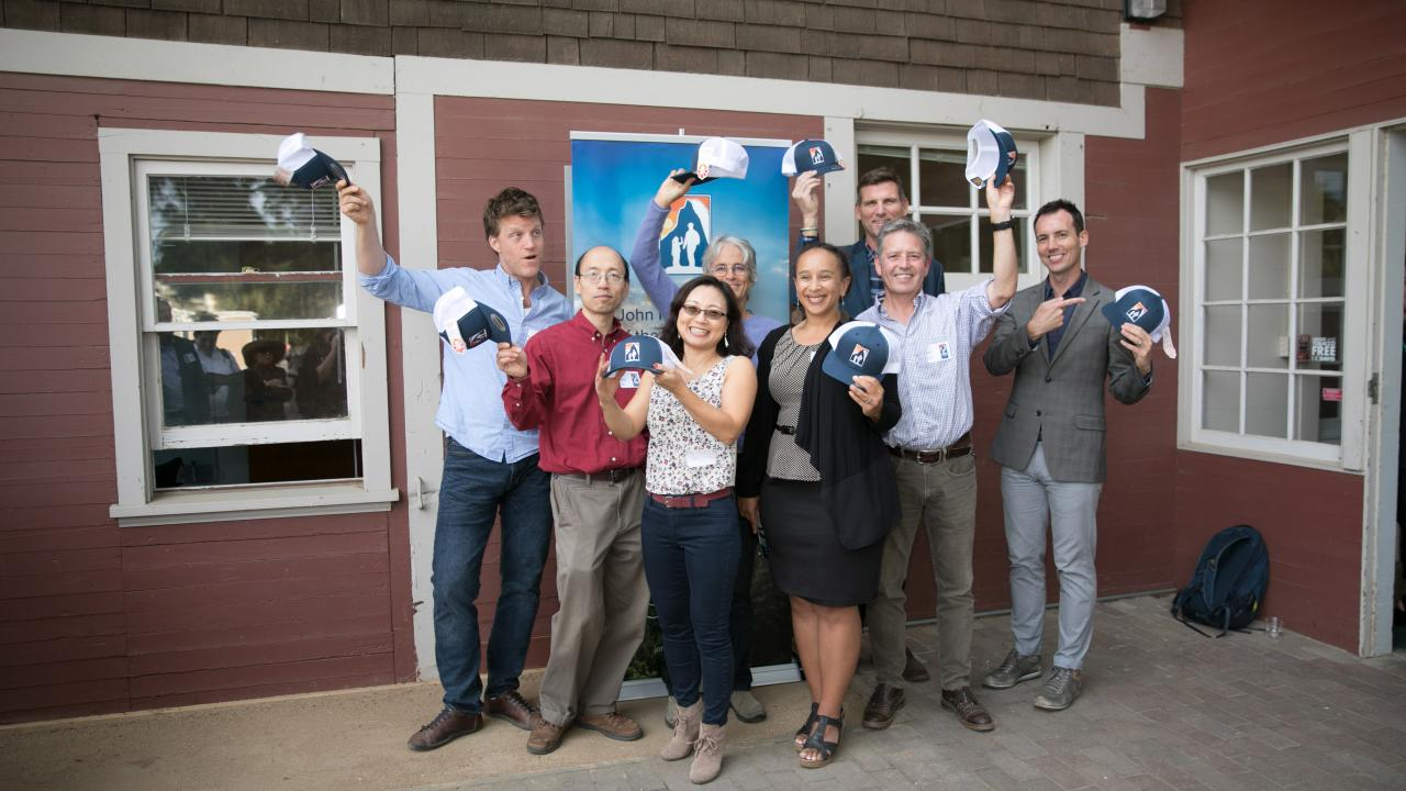 The 2018 Fellows show off their Muir Institute hats during the institute's annual open house at The Barn on October 23. From left to right: Ian Faloona, Albert Lin, Yufang Jin, Susan Harrison, Beth Rose Middleton, Steven Ostoja, Chris Vogel and Ben Houlton. (Lisa Howard/UC Davis)