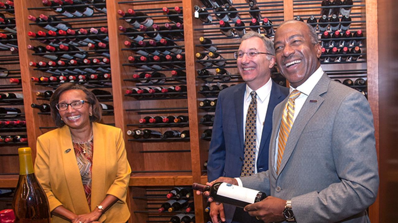 Viticulture and Enology Professor David Block (center) recently gave a tour of the campus winery to Dean Helene Dillard and UC Davis Chancellor Gary May.