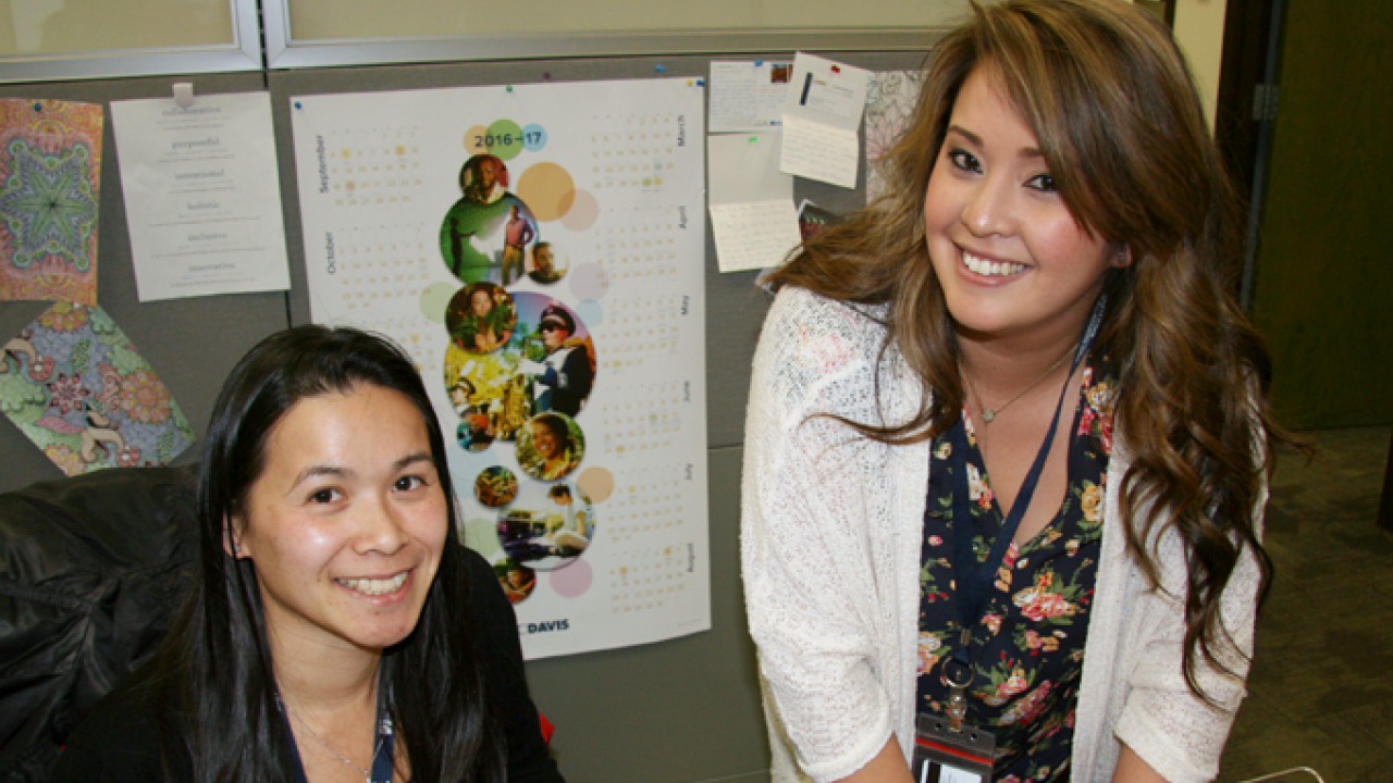 Hong Dao, CA&ES academic advisor (left), works with Katherine Parpana in the CA&ES advising office.