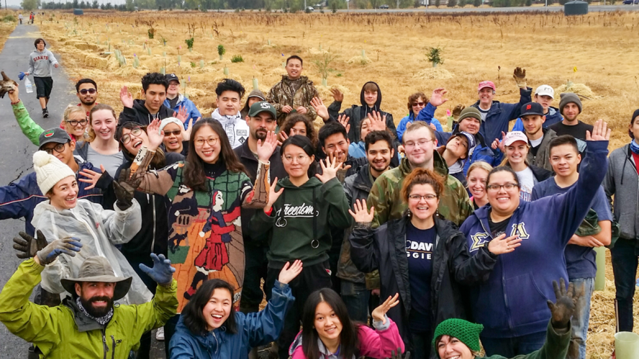 A group of 21 CAES students, joined by staff from the dean's office, recently spent a Saturday helping plant more than 300 trees and shrubs with the Sacramento Tree Foundation at the Bear River Habitat trail in Yuba County.