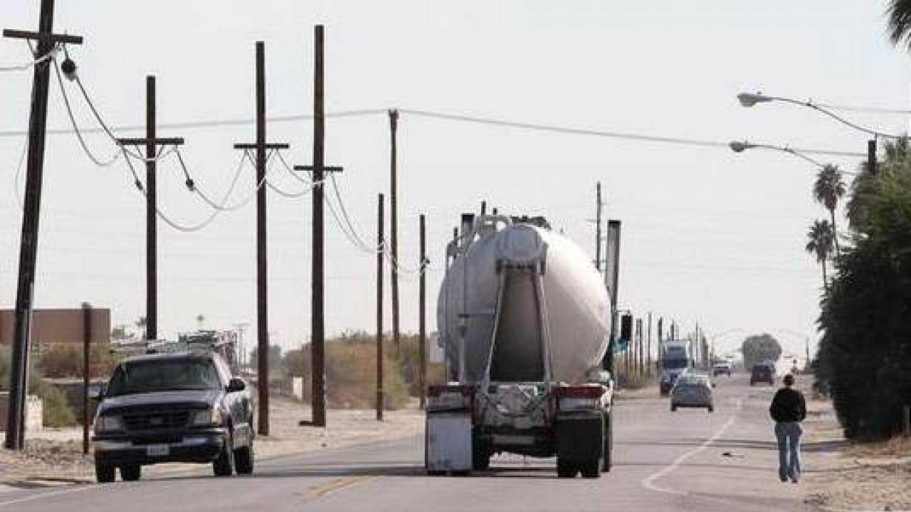 Traffic moves along Highway 111 in Thermal, Calif. (photo: Jay Calderon, The Desert Sun)