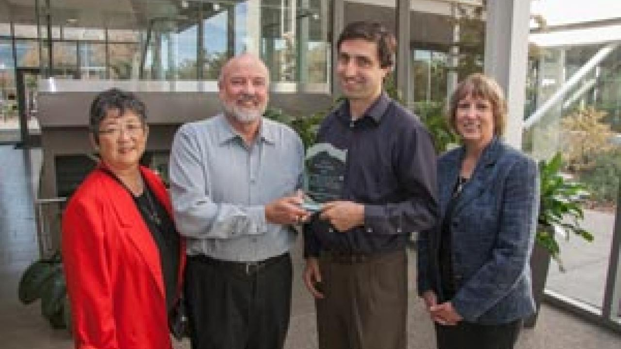 David Hosley (second from left) receives the inaugural Distinguished Service Award from Center for Regional Change director Jonathan London. Also present: Hosley's wife gayle yamada (left), and Mary Delany, interim dean of the CA&ES. Photo John Stumbos