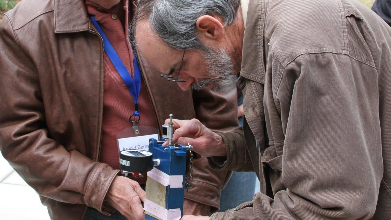 Professor Ken Shackel (right), UC Davis, demonstrates a pressure chamber to Arnold Bernstein, a rare-fruit farmer from Malibu, Calif., at the recent Pomology Short Course at UC Davis.