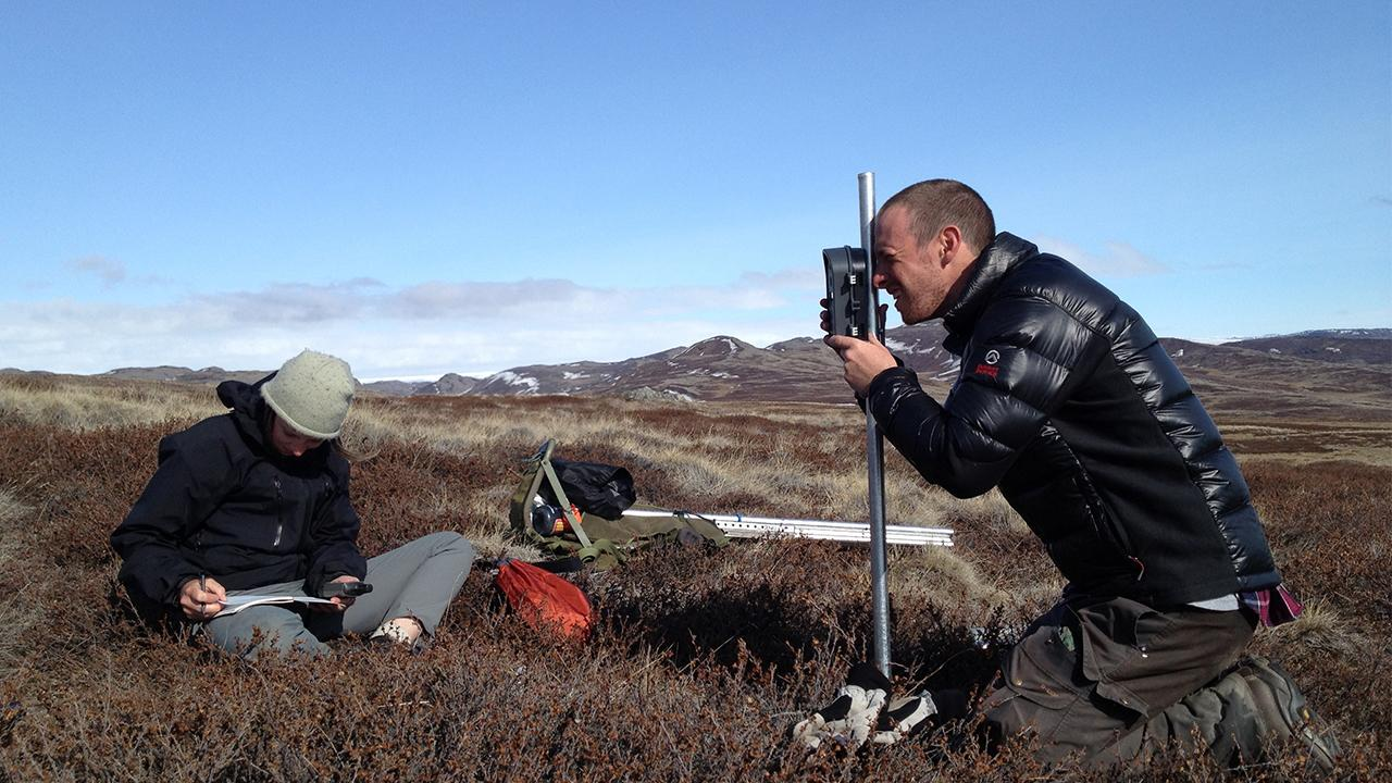 Jeff Kerby, a former doctoral student in the Post lab, installs a time-lapse camera on a caribou calving range near Kangerlussuaa, Greenland. Assisting him is Ellorie McKnight, a student volunteer from Canada. Since 2012, 50 such cameras distributed throughout the long-term study site have been snapping five photos daily and capturing detailed information on trends in the timing of snow seasonality and plant green-up as the climate warms. ERIC POST/UC Davis
