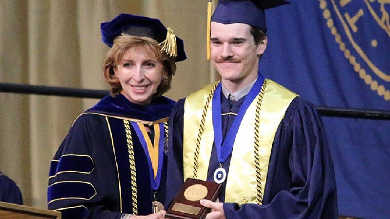 UC Davis Chancellor Linda P.B. Katehi presents the 2015 University Medal for excellence to CA&ES graduate Andrew Magee. (Photo by Chris Nicolini | UC Davis)