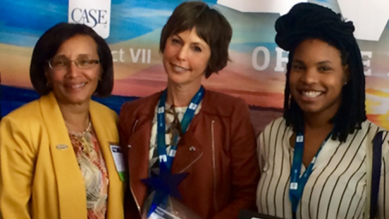 Dean Helene Dillard congratulates Pam Pacelli (center) and Charleen Floyd (right) at the CASE awards conference.
