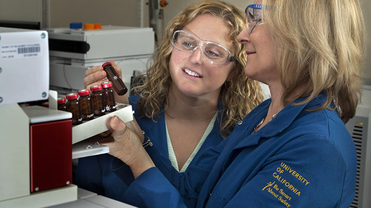 Adjunct professor Jenny Nelson and Professor Alyson Mitchell in the UC Davis Food Safety and Measurement Facility examine samples of almond volatiles. (Tony Novelozo | AXIOM)