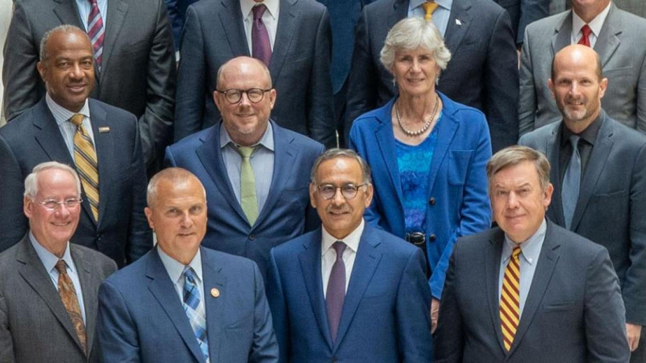 Chancellor May, top left, in group photo at Aug. 7 launch of the National Commission on Innovation and Competitiveness Frontiers. (Courtesy Council on Competitiveness)