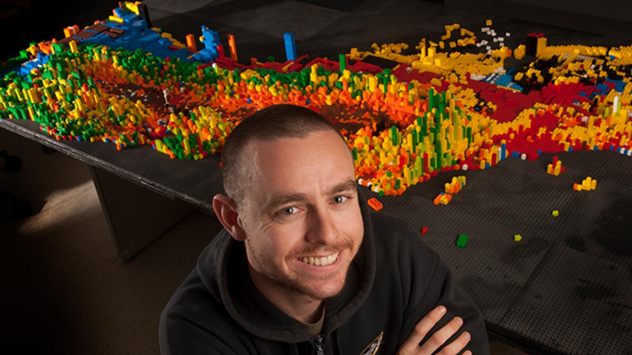 Recent graduate Chris Zaleski is assembling a topographical Lego map of California. (Gregory Urquiaga/ UC Davis)