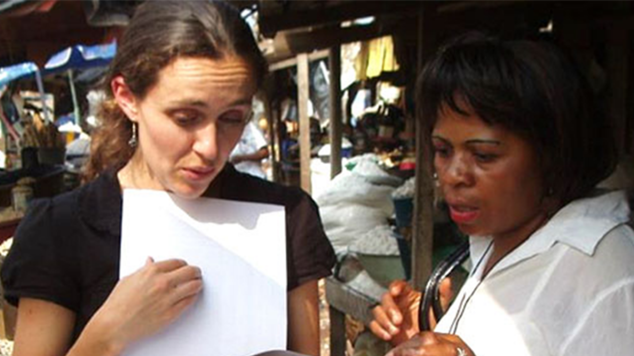 Reina Engle-Stone confers with Lucienne Nyangono from Helen Keller International. In 2009, Engle-Stone was part of a team of researchers who collected data on dietary intakes in the different regions of Cameroon in West Africa. The data was used to help Cameroon develop its fortification program for wheat flour and cooking oil.