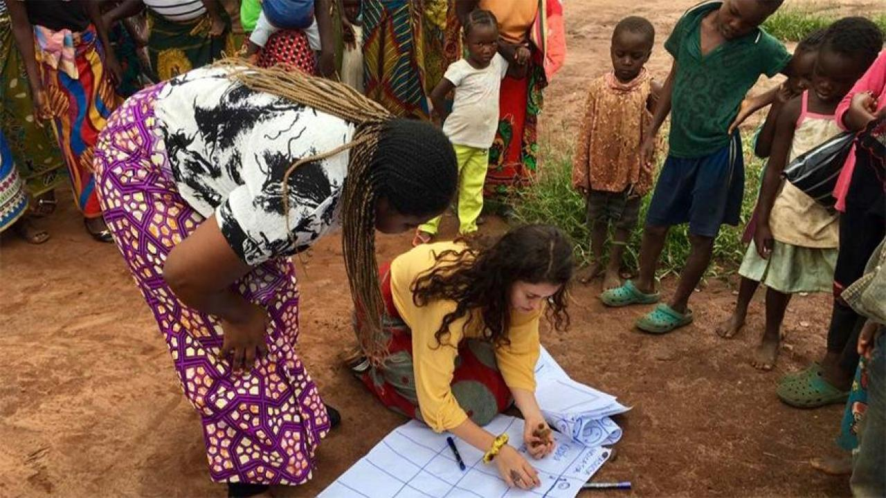 UC Davis alumna Whitney Galindo, kneeling, serves as a community health educator in Zambia. (Courtesy photo)