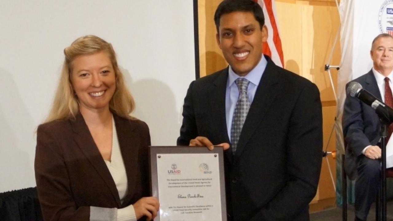 Elana Peach-Fine receives an award from Raj Shah, USAID administrator, for her work as a graduate student with the Horticulture Collaborative Research Support Program. The award was presented at a BIFAD meeting in Washington, D.C. (photo: Mark Varner/APLU