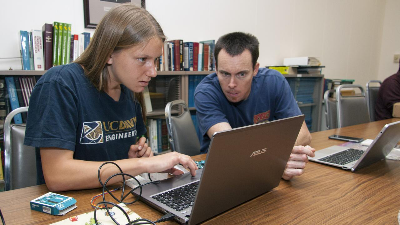 Kelley Drechsler (left), a biological systems engineering student, consults with Ryan Billing, a development engineer in the Department of Biological and Agricultural Engineering.