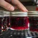 Fresh jelly is prepared in jars.