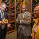 Department of Viticulture and Enology Chair David Block (left) visits with UC Davis Chancellor Gary May and College of Agricultural and Environmental Sciences Dean Helene Dillard.
