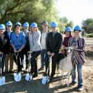 "Breaking ground on the new goat dairy and creamery are representatives of the College of Agricultural and Environmental Sciences, Department of Animal Science and UC Davis Design and Construction Management. Standing from left to right are Hannah Bill, Rob Scharf, Dan Sehnert, Jim Carroll, Kelly Wade, Jim Murray, Anita Oberbauer, Glen Webber, Brent Gesell, Jamie Ribeiro-Irwin, and Brittany Cavaletto. And that's ""Tiramisu,"" a LaMancha goat, on the left and ""Zinfandel,"" an Alpine goat, on the right."
