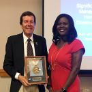 Distinguished entomology professor Frank Zalom receives the 2017 Morrison Medal from Chavonda Jacobs-Young, the USDA-ARS administrator, at a September ceremony in Hawaii.