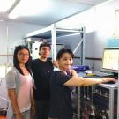 Qi Zhang (right) operates an aerosol mass spectrometer with Ph.D. student Shan Zhou (left) and project scientist Sonya Collier (center) during 2014 field study in Nanjing, China.