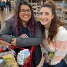 Ruby Bal, left, and Co Hawes are pictured at Trader Joe's last week, with a shopping cart full of food. They were joined by Layne DeLorme on a grocery run for The Pantry, using the snack money from a canceled event. (Layne DeLorme/UC Davis)