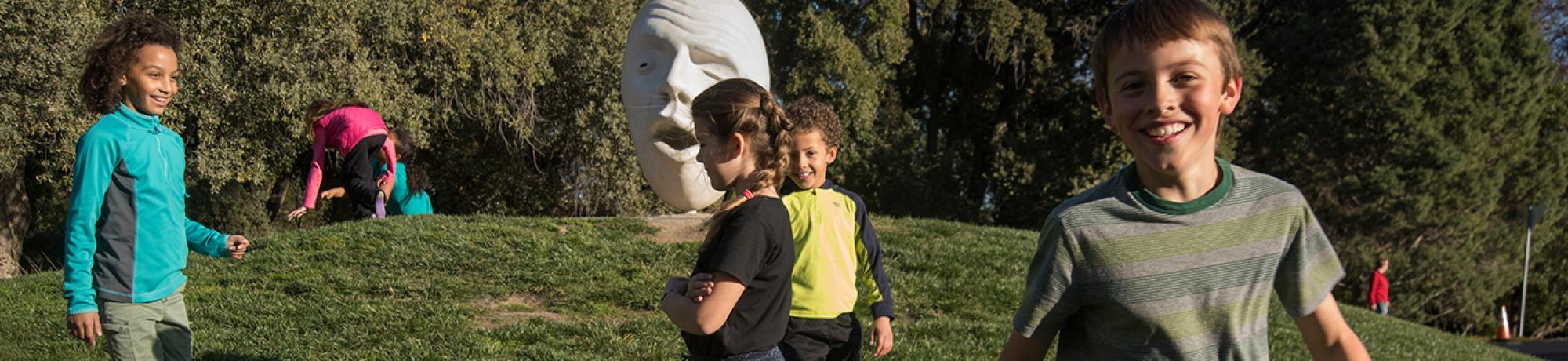 Kids running around egghead at UC Davis.